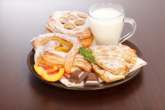 Various cakes and milk breakfast Stock Photo