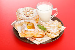 Various cakes and milk breakfast Royalty Free Stock Photography