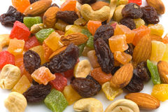 Various candied fruits and nuts. On a white background. It is possible to use as wallpaper on a desktop stock photography