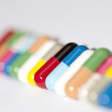 Various capsules in row Stock Photography