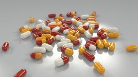 Various capsules on a table stock photo