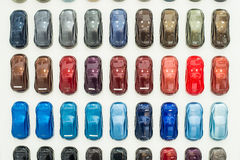 Various car metallic paint samples on stand. Car metallic paint samples, stand with examples of glowing colors coating for different vehicles, bronze, brown royalty free stock image