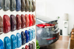 Various car metallic paint samples on stand. Car metallic paint samples, stand with examples of glowing colors coating for different vehicles, bronze, brown stock photography