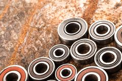 Various car parts and accessories, on metal  background - Image. Various car parts and accessories, on metal  background bearings stock image