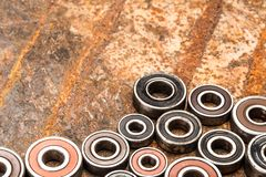 Various car parts and accessories, on metal  background - Image. Various car parts and accessories, on metal  background bearings stock photos