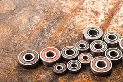 Various car parts and accessories, on metal  background - Image. Various car parts and accessories, on metal  background bearings royalty free stock photos