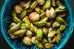 Various Cardamom Spices in Authentic Turkish Bowl Royalty Free Stock Images
