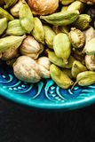 Various Cardamom Spices in Authentic Turkish Bowl Stock Images