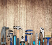 Various carpentry and DIY tools. Various carpentry, repairing, DIY tools on wooden background Royalty Free Stock Photos