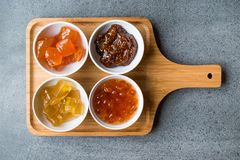 Various Ceramic bowl of Fruit jams Fig, Quince, Bergamot Citrus, Watermelon in wooden tray / Marmalade. stock photography