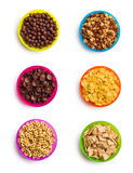 Various cereals in colorful bowls Royalty Free Stock Photos