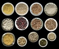 Various cereals, seeds, beans, peas on plates isolated on black background, top view. stock image