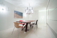 Various chairs in dining room stock photography
