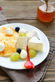 Various cheese and berry Royalty Free Stock Image
