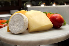 Various cheese and fruits on  cutting board Royalty Free Stock Image