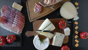 Various Cheese And Salami. Top view of table with various types of cheese and salami stock footage