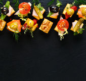 Various cheese skewers  on a black background Royalty Free Stock Images