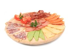 Various cheese on wooden platter. Stock Image