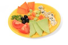 Various cheese on yellow platter. Stock Photography