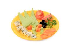 Various cheese on yellow platter. Royalty Free Stock Images