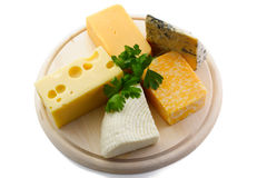 Various cheeses on catting board Stock Photo
