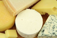 Various cheeses Stock Images