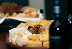 Dish of diverse cheeses. Various cheeses dish with dried fruits and wine Royalty Free Stock Photos