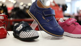 Various children`s shoes in shop stock video
