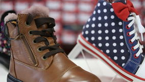 Various children`s shoes in shop stock footage