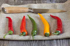 Various chili peppers on a jute fabric Stock Photography