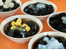 Various Chinese Desserts. Chinese grass jelly dessert with various condiments stock image