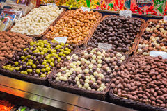 Various chocolate balls, candies and sweets with price tags Royalty Free Stock Photography