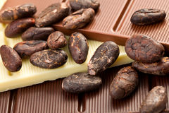 Various chocolate bars with cocoa beans Royalty Free Stock Images