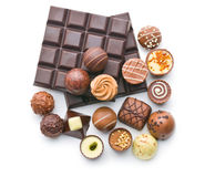 Various chocolate pralines and chocolate bar Stock Photos