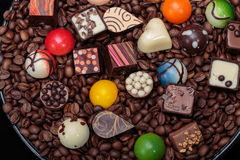 Various chocolate pralines and coffee beans Stock Photos
