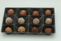 Various chocolates in a tray Stock Photography