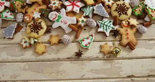 Various christmas cookies and cinnamon on a plank stock video footage