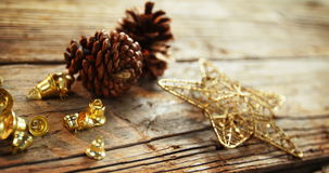 Various christmas decoration arranged on a plank stock footage