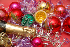 Various christmas decorations. And a bottle of champagne royalty free stock photos