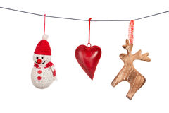 Various Christmas decorations hanging on string isolated Royalty Free Stock Photo