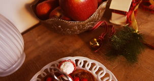 Various christmas desserts and decorations on wooden table. During christmas time 4k stock video