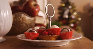 Various christmas desserts on plate. During christmas time 4k stock video