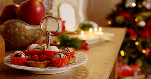 Various christmas desserts on wooden table stock footage