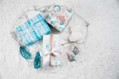 Various Christmas presents in home. Blue, white Royalty Free Stock Image