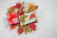 Various Christmas presents in home. Red, white Stock Image