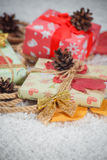 Various Christmas presents in home. Red, white Stock Images