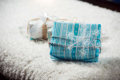 Various Christmas presents in home. White blue Stock Photos