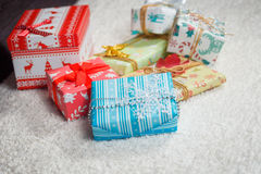 Various Christmas presents in home. White blue Stock Photography