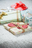 Various Christmas presents in home. White, red Royalty Free Stock Photo