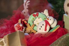 Various Christmas sweet colorful cookies with christmas tree on wood table royalty free stock image